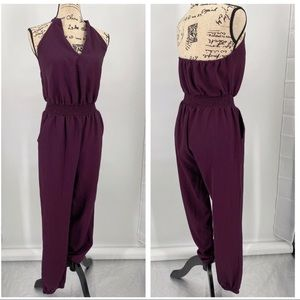Love and fire halter neck jump suit size M
